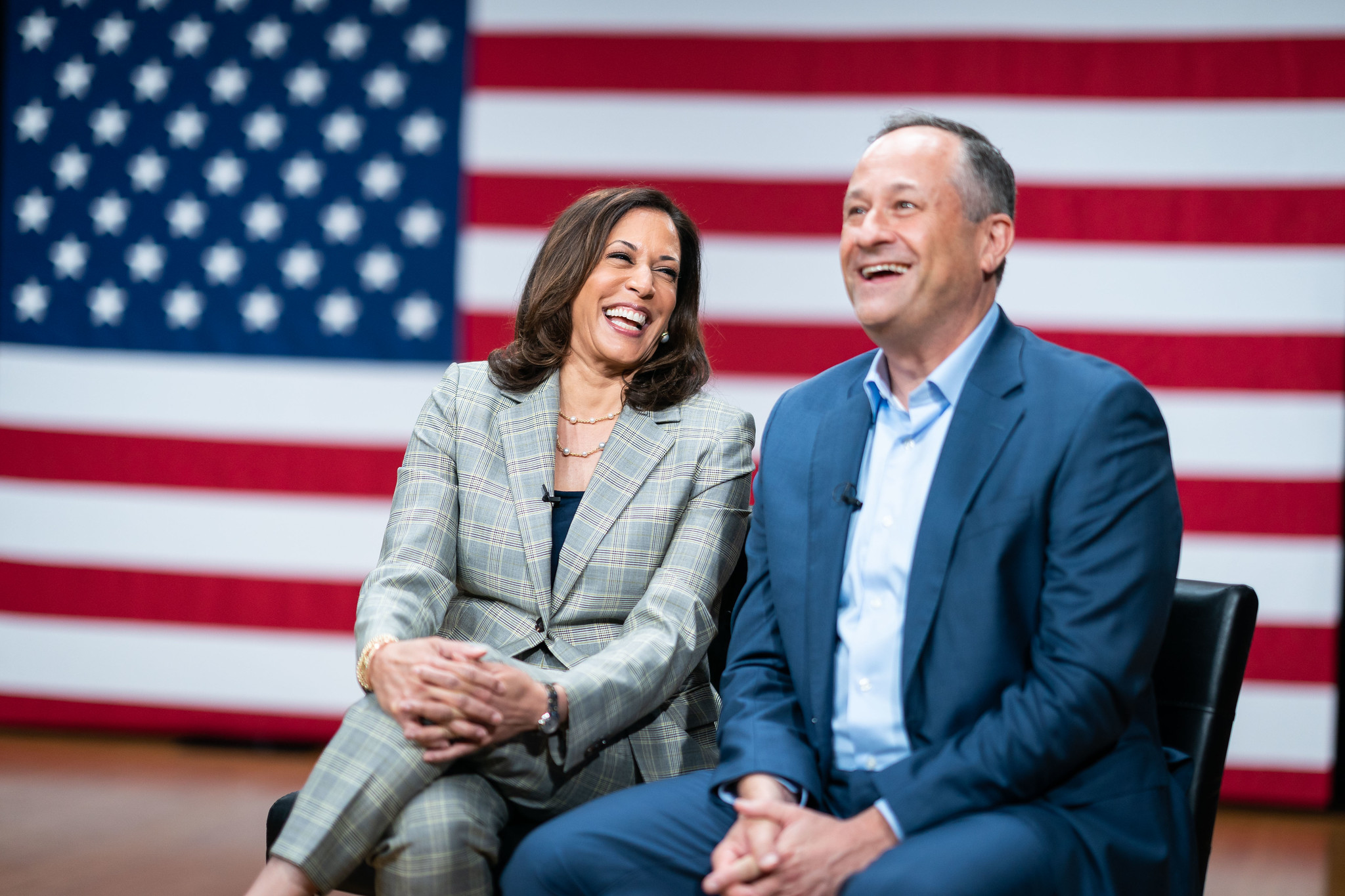 Doug Emhoff (right) sits onstage with his wife, Kamala Harris (left)